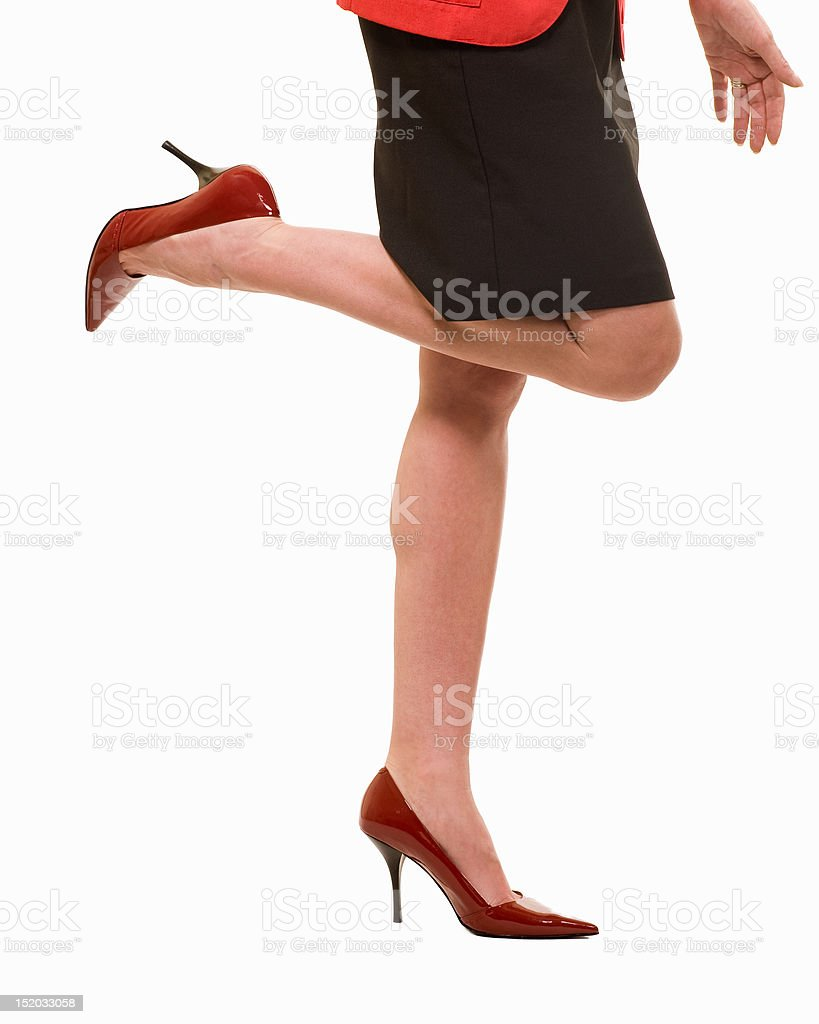 Sexy business woman legs wearing heels royalty-free stock photo