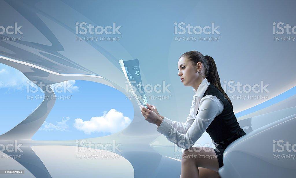 Sexy businesswoman examining future digital report / newspaper royalty-free stock photo
