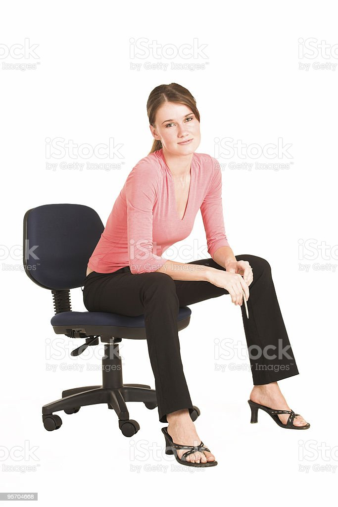 Sexy Businesswoman on office chair royalty-free stock photo