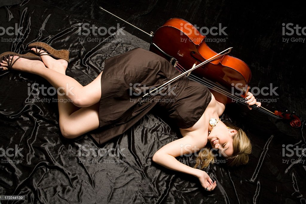 Sexy cellist relaxing stock photo