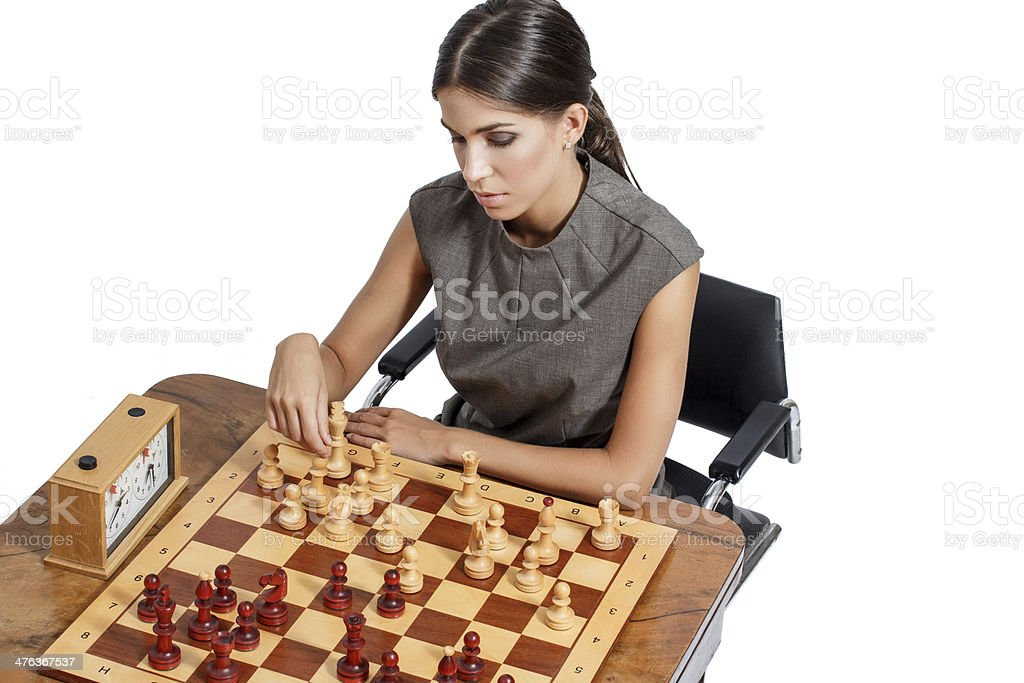 Sexy clever brunette woman playing chess royalty-free stock photo