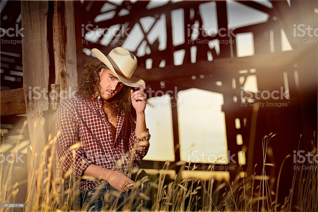 Sexy Country Cowboy In Rural Setting stock photo