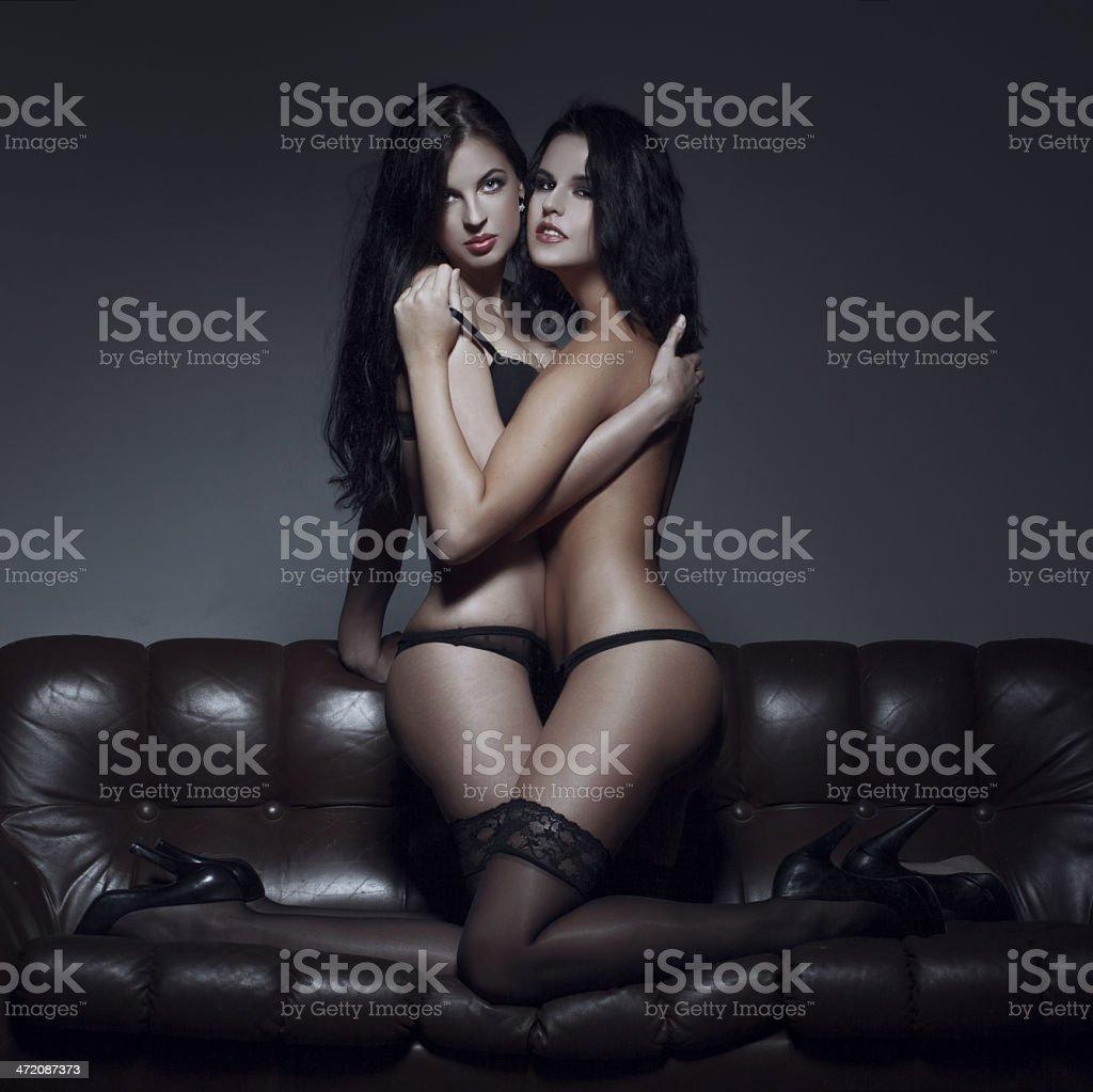 Sexy couple foreplay on sofa stock photo