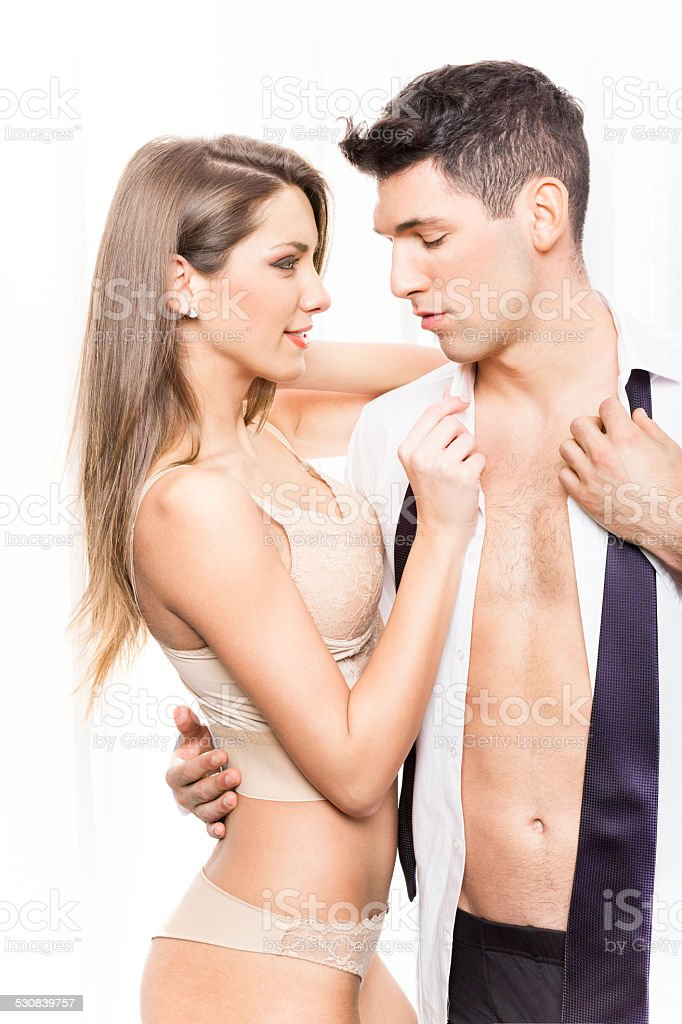 Sexy couple in semi-dress stock photo