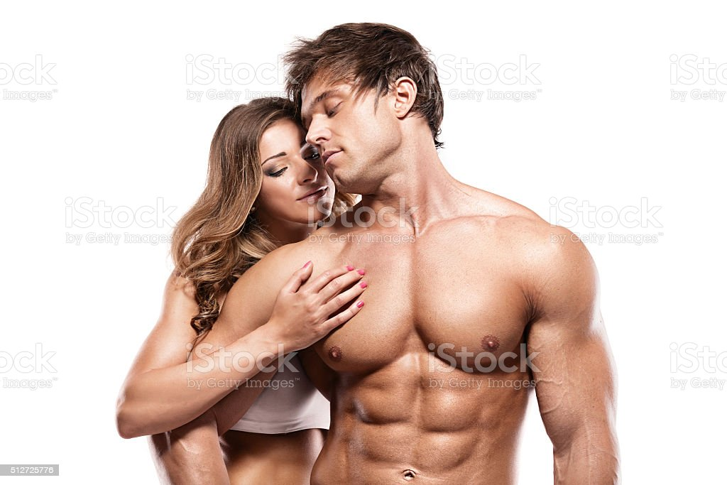 sexy couple, muscular man holding a beautiful woman stock photo