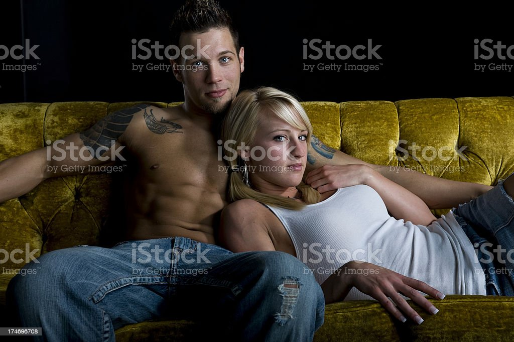 Sexy Couple On A Vintage Couch(XL) royalty-free stock photo