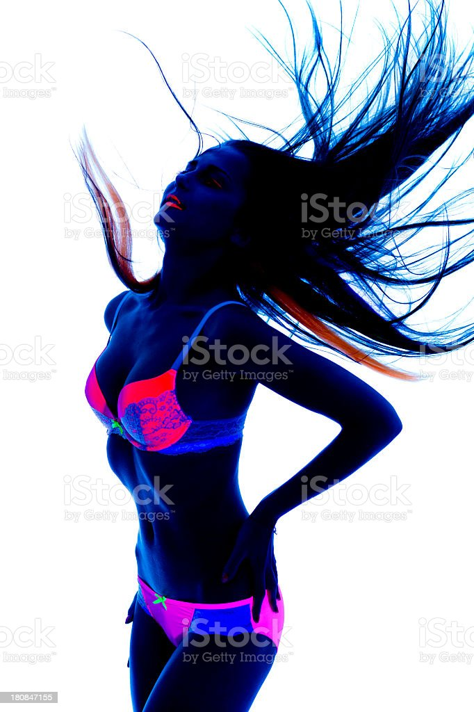 Sexy dancer in black light royalty-free stock photo