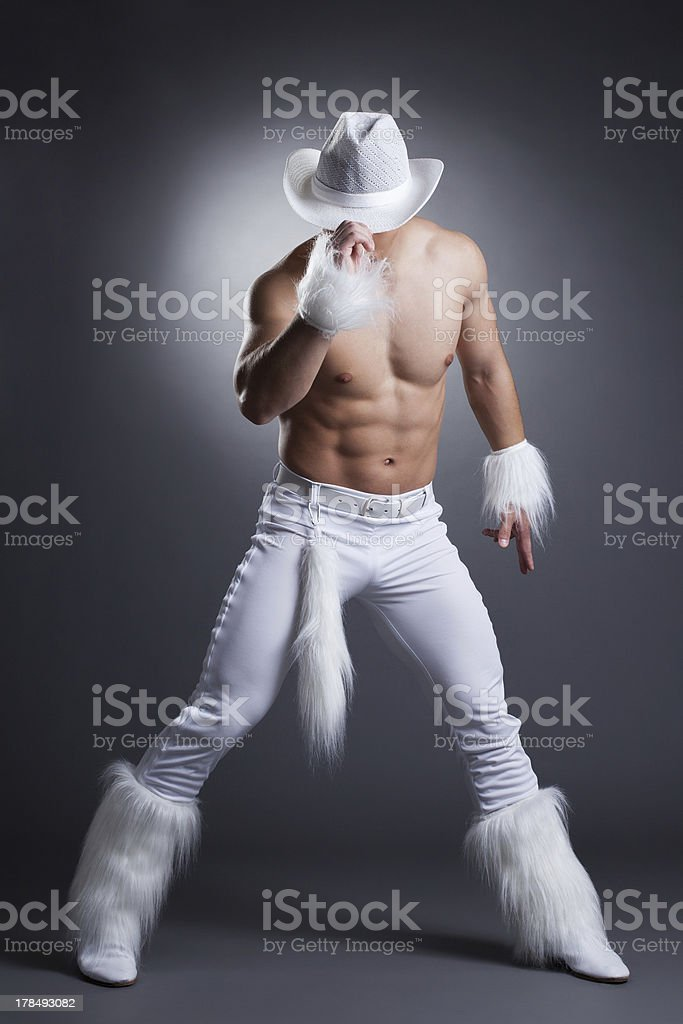 Sexy dancer in white cowboy costume royalty-free stock photo