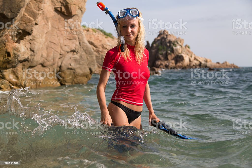 Sexy diver girl in sportwear preparing her dive stock photo
