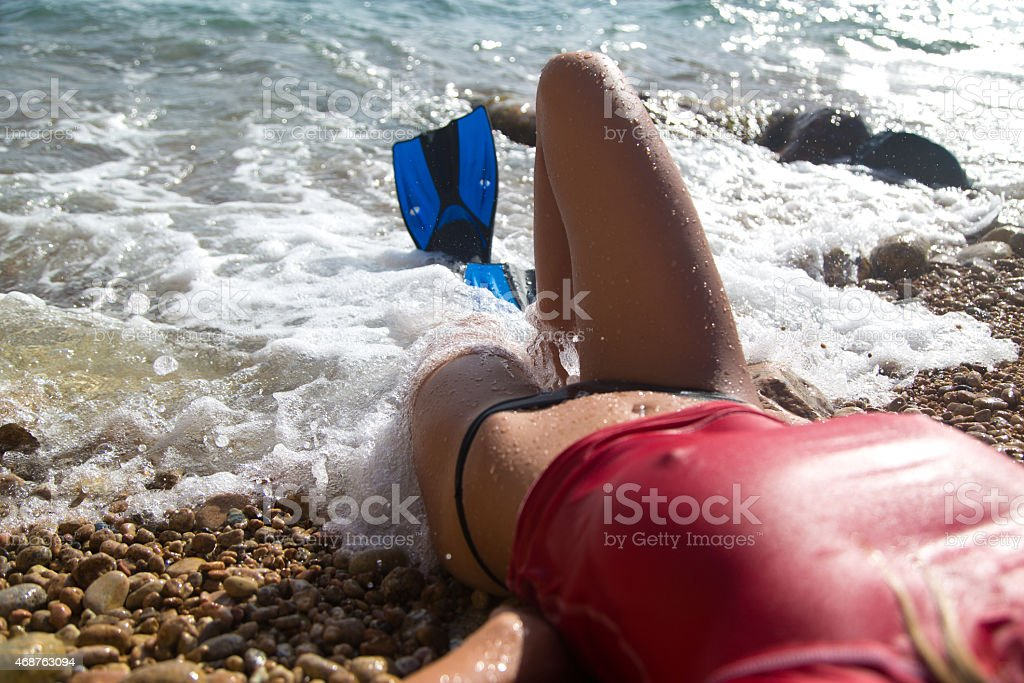 Sexy diver girl with the flipper stock photo