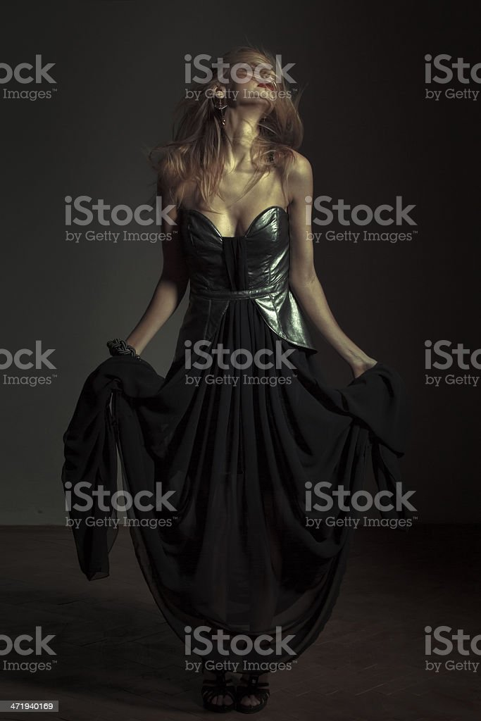Sexy emotional woman posing in evening dress royalty-free stock photo