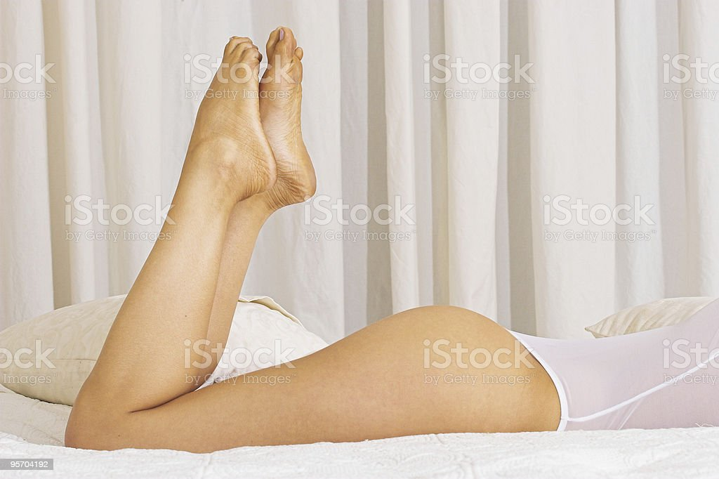 Sexy feet and bottom in white lingerie royalty-free stock photo