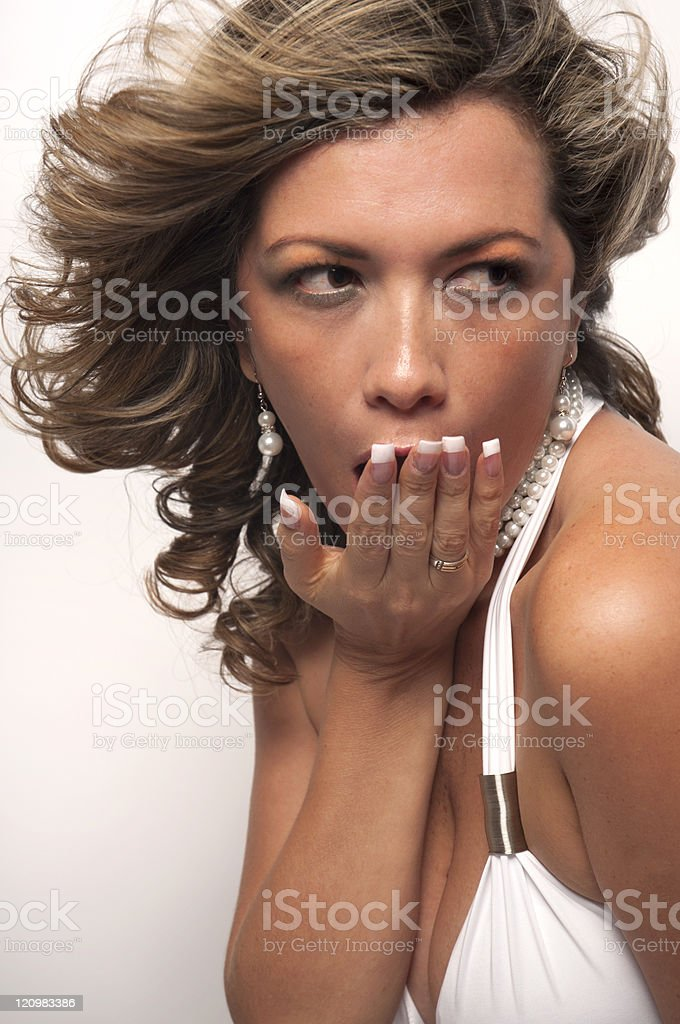Sexy Female Blowing A Kiss With White Dress And Cleavage stock photo