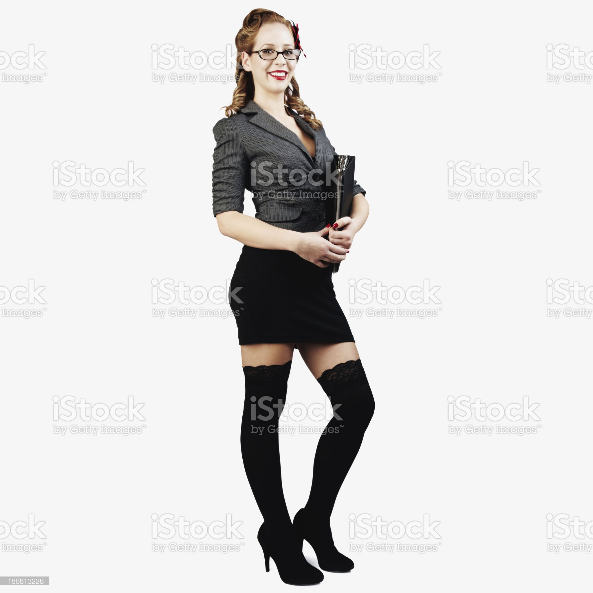 Sexy Female College Student Holding Notebook and Smiling. Isolated royalty-free stock photo