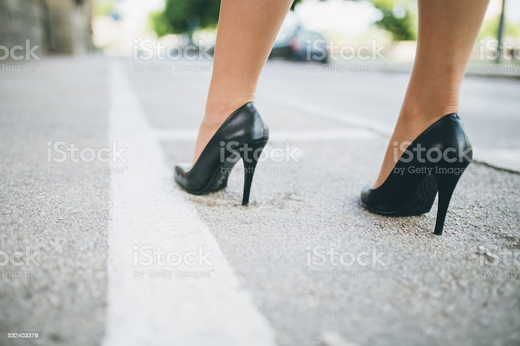 Sexy female high heeled black shoes on the way stock photo