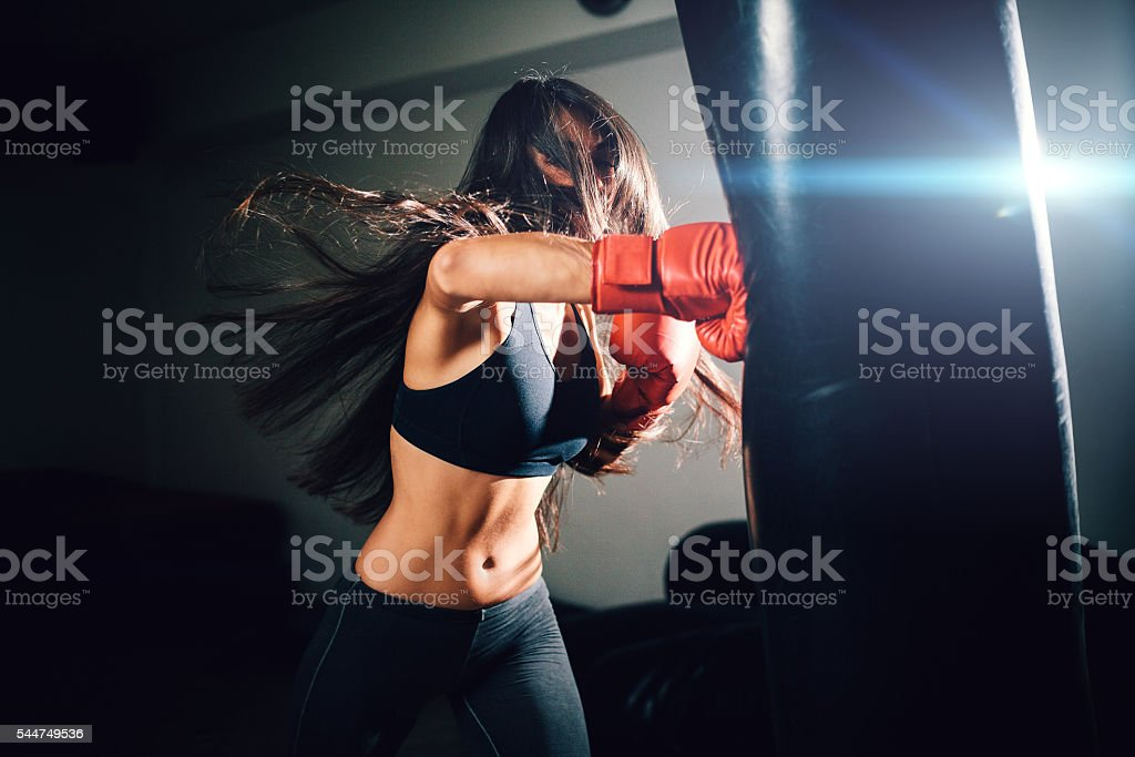 sexy fighter girl punching actively stock photo