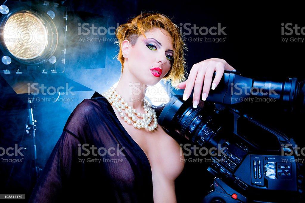 Sexy filmmaker stock photo
