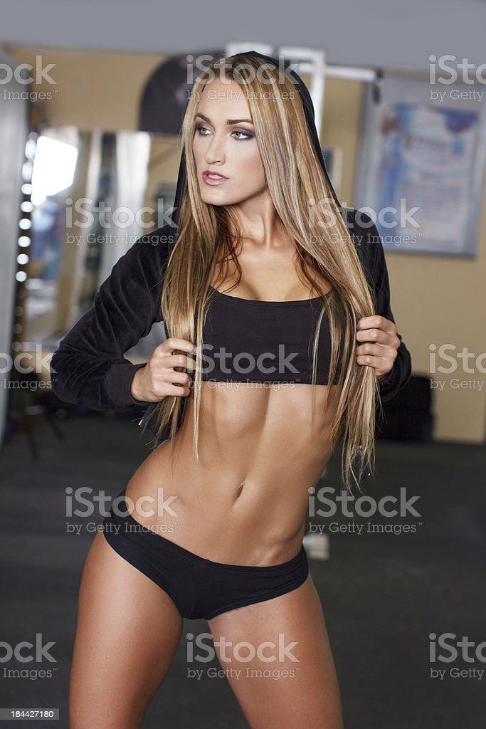 Sexy fitness model posing royalty-free stock photo