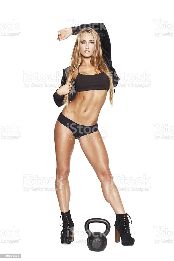 Sexy fitness model posing with kettlebell royalty-free stock photo