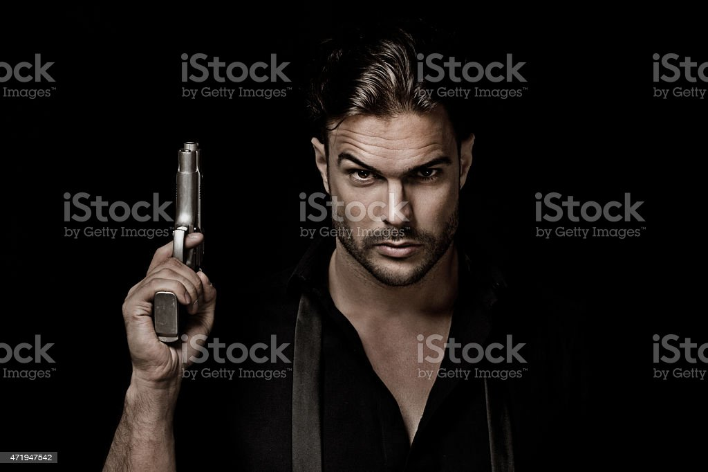 sexy gangster holding gun stock photo