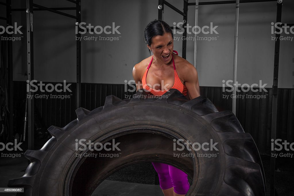 Sexy Girl Flipping Tire stock photo