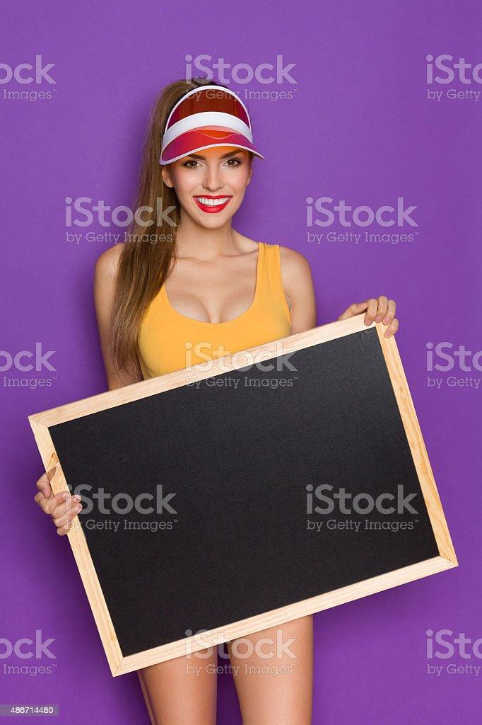 Sexy Girl Holding A Blackboard stock photo