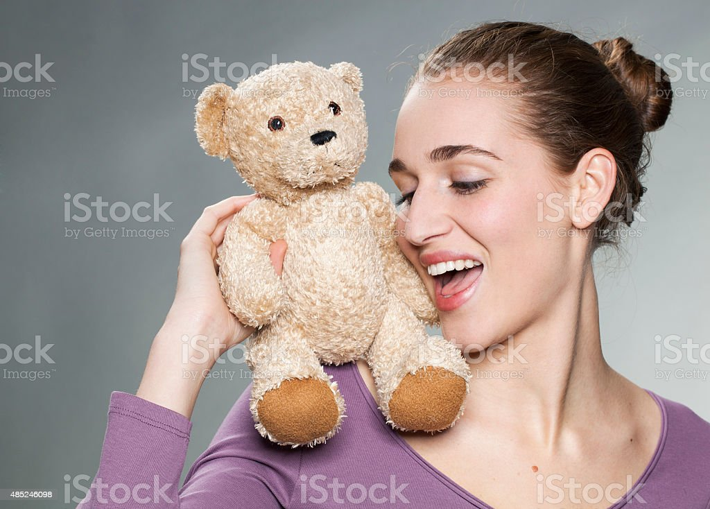 sexy girl holding her favorite comforter with emotion stock photo