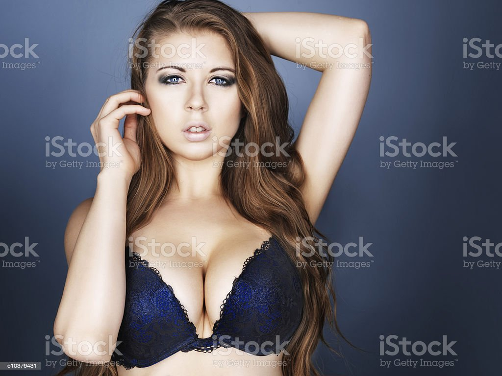 sexy girl in bra and long hair stock photo