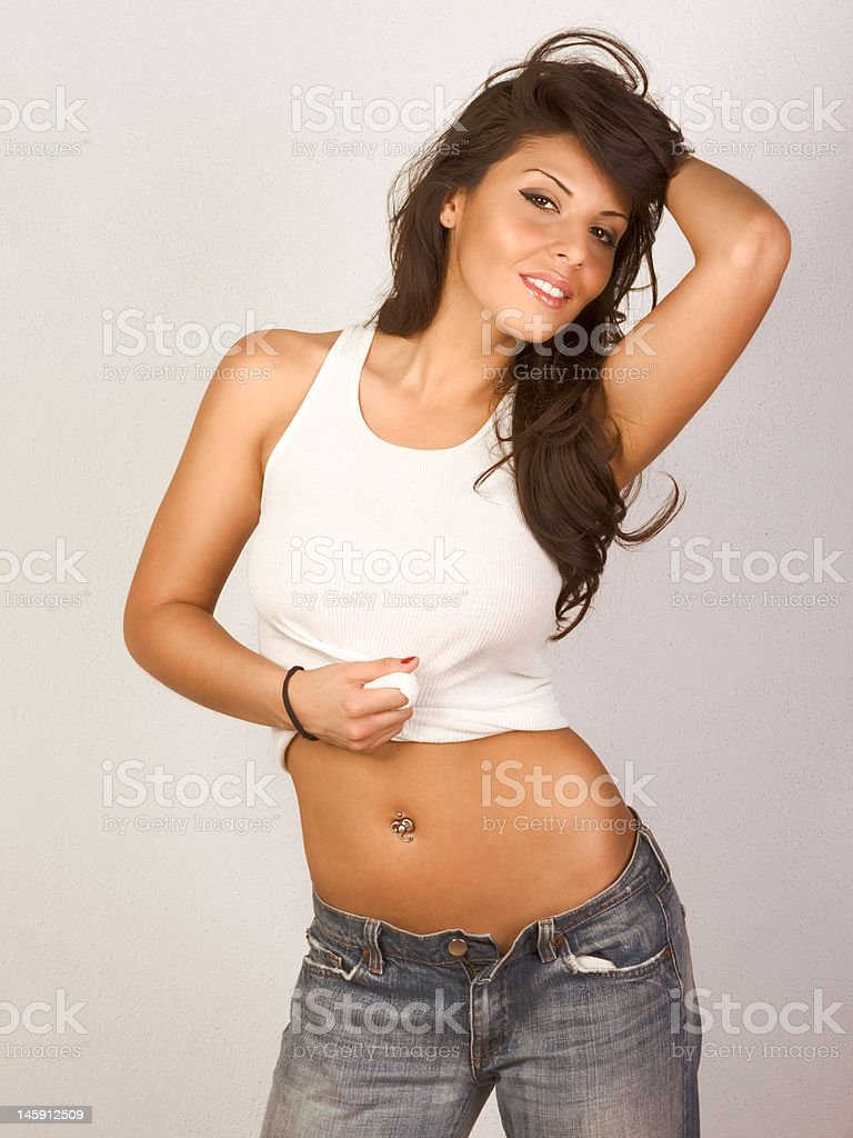 Sexy girl in jeans and tank-top royalty-free stock photo