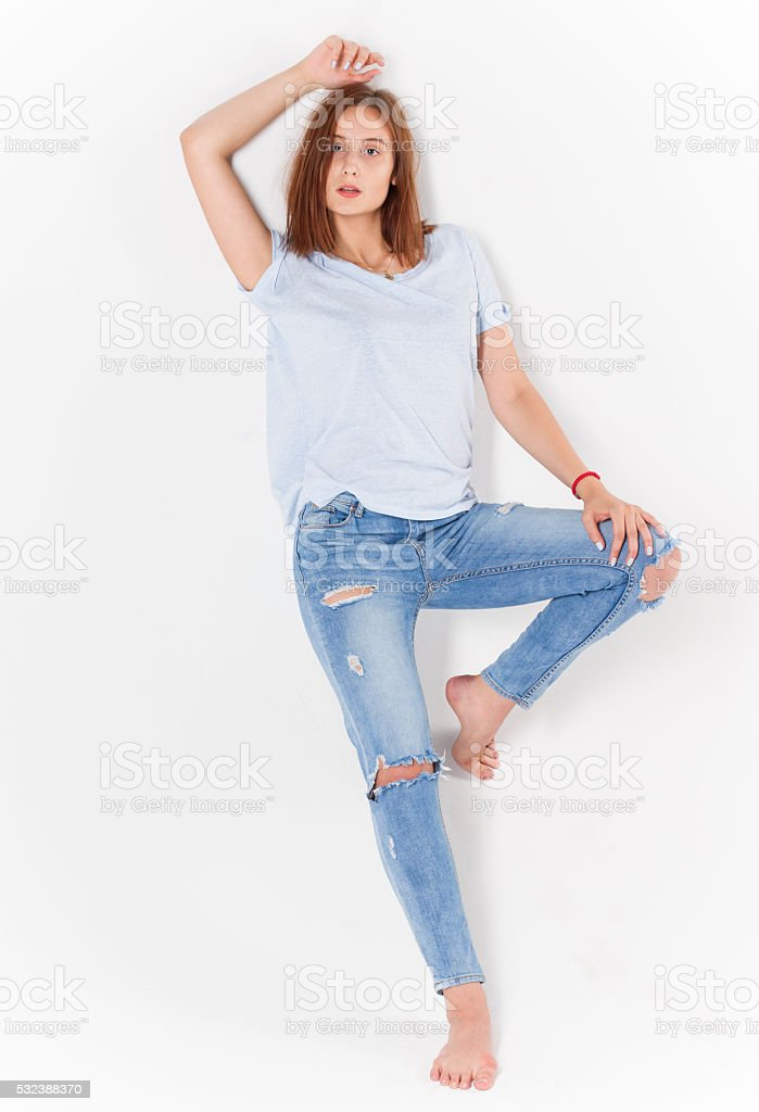 sexy girl in jeans on white background stock photo