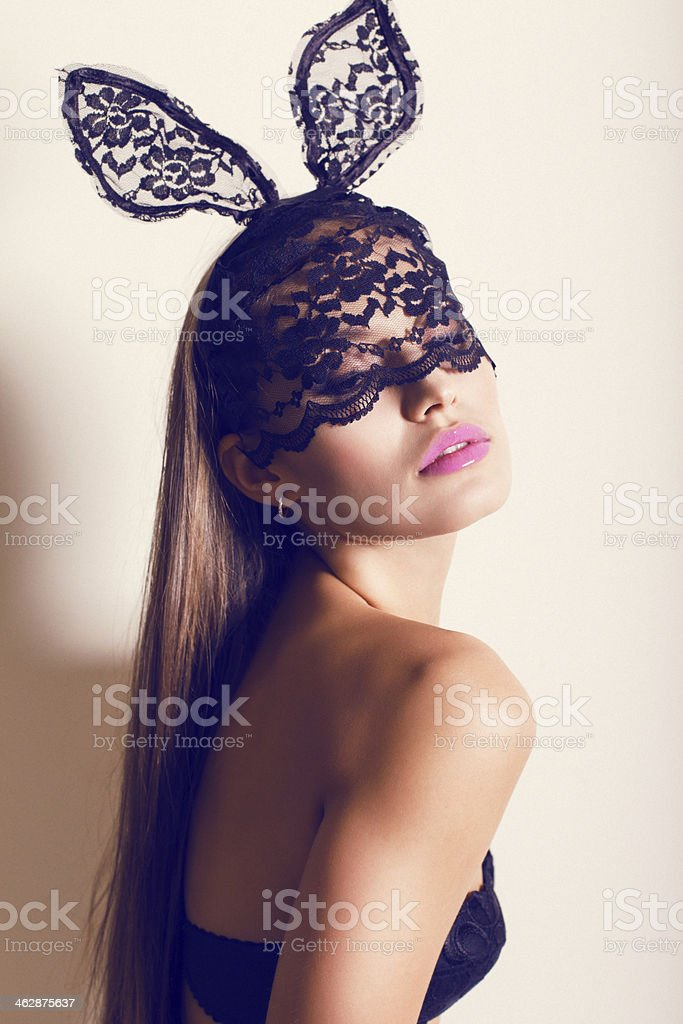sexy girl in lace bunny's mask stock photo