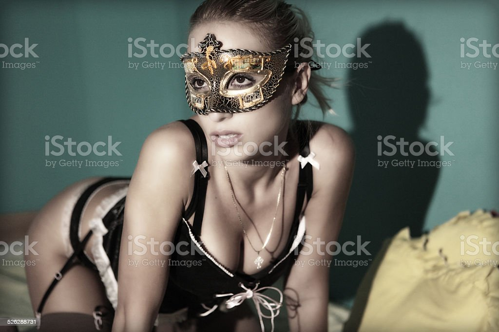 Sexy girl in lingerie with mask stock photo