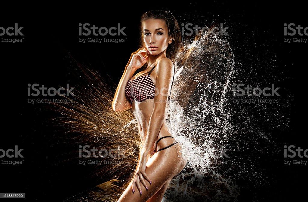 Sexy girl in water splash stock photo