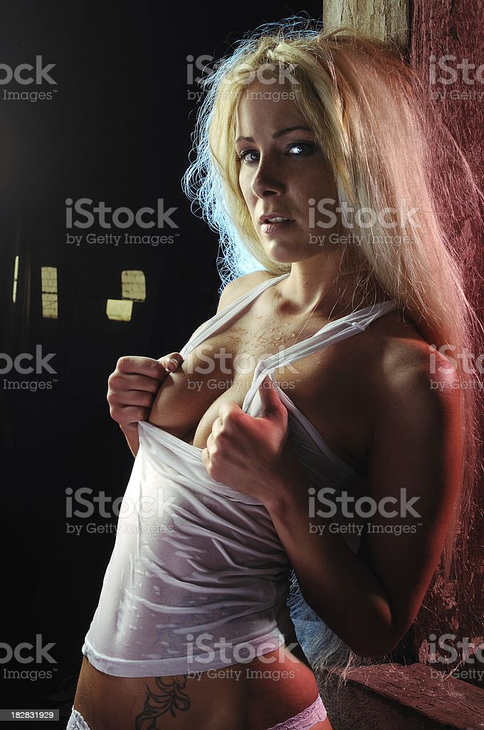 Sexy girl in wet shirt royalty-free stock photo