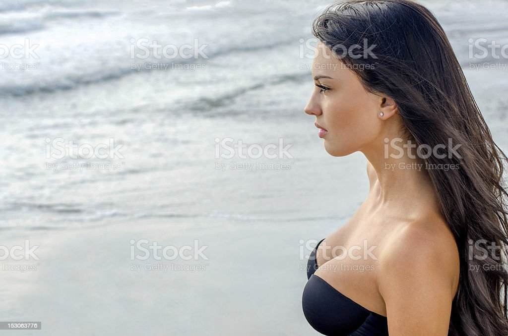 Sexy girl looking at the sea stock photo