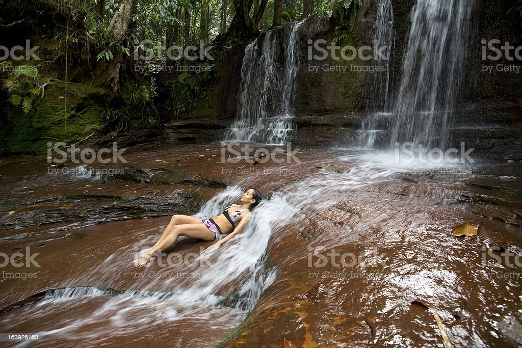 sexy girl lying down in river royalty-free stock photo