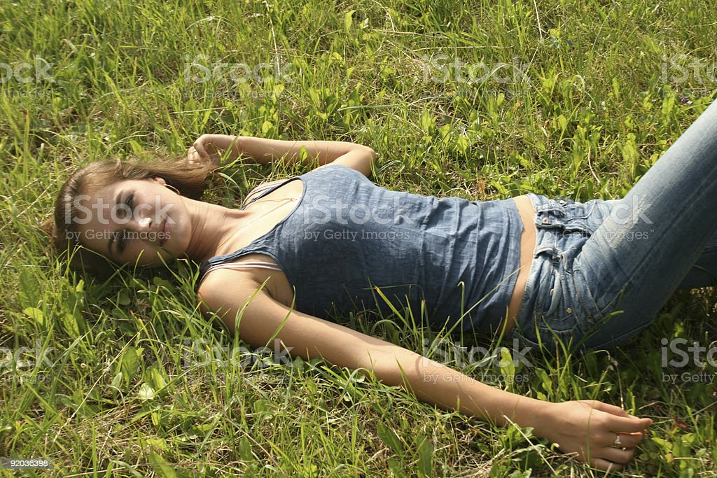 Sexy girl lying on grass royalty-free stock photo