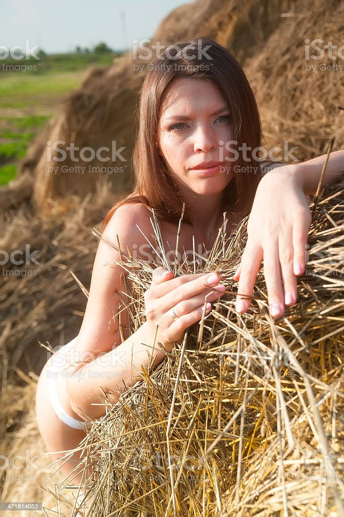 sexy girl on hay stack royalty-free stock photo