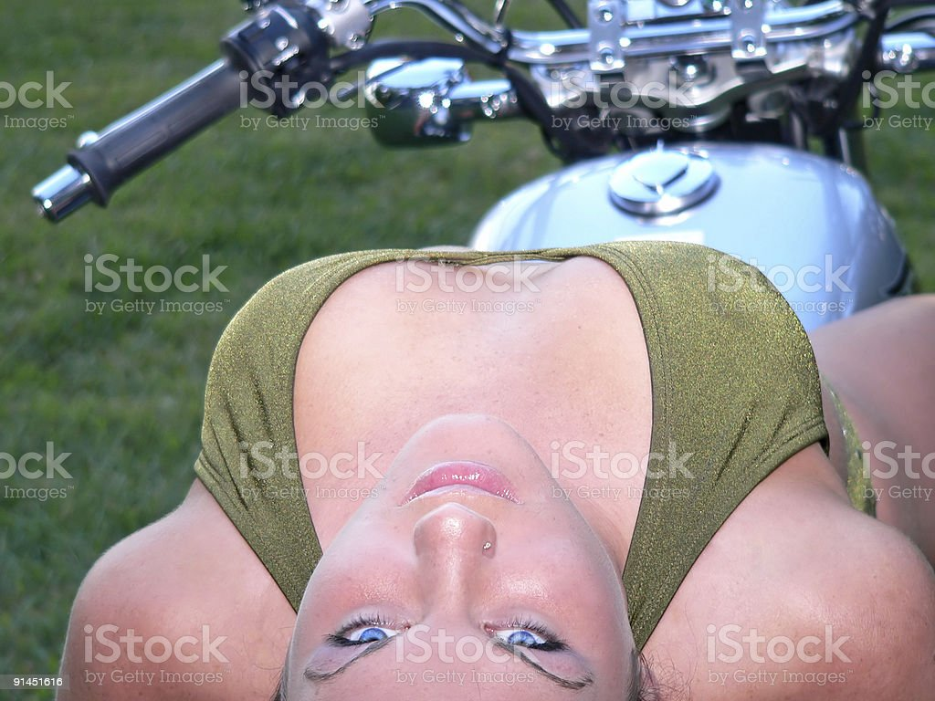 Sexy girl on motorcycle laying back royalty-free stock photo