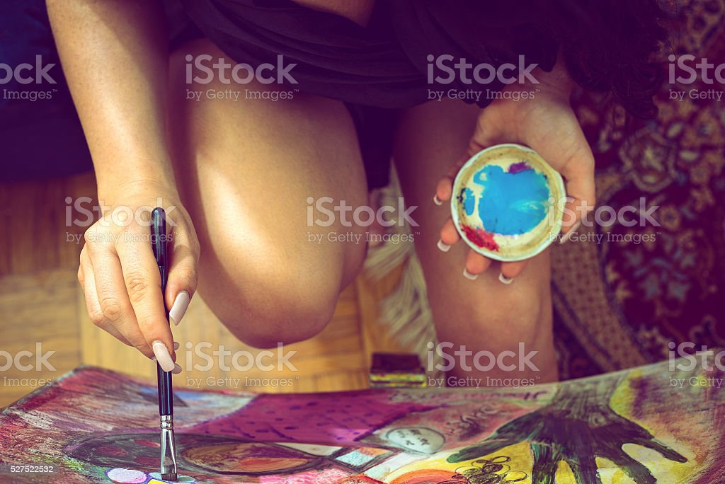 Sexy girl painting on canvas stock photo