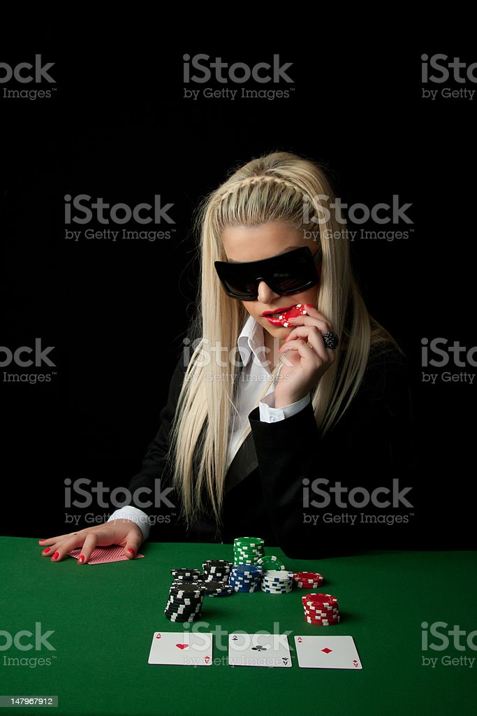 Sexy girl playing poker in Casino royalty-free stock photo