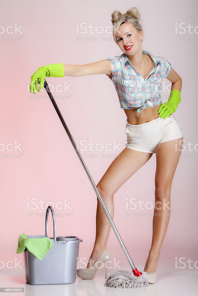 Sexy girl retro style, woman housewife cleaner with mop royalty-free stock photo