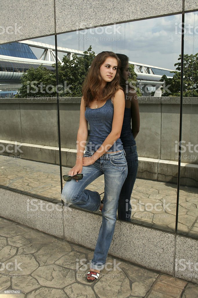 Sexy girl standing in front of a mirror wall royalty-free stock photo