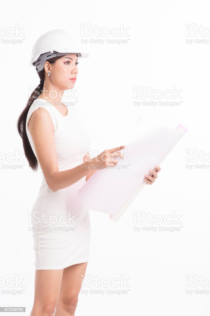 Sexy girl structural engineer looking at work stock photo