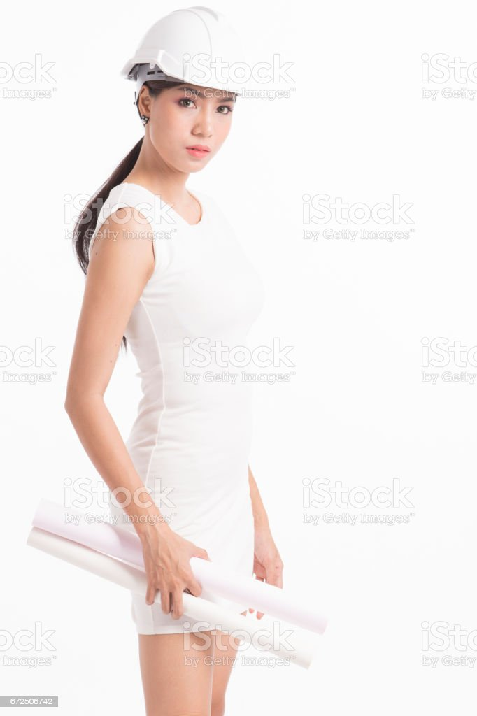 Sexy girl structural engineer with drafting paper stock photo