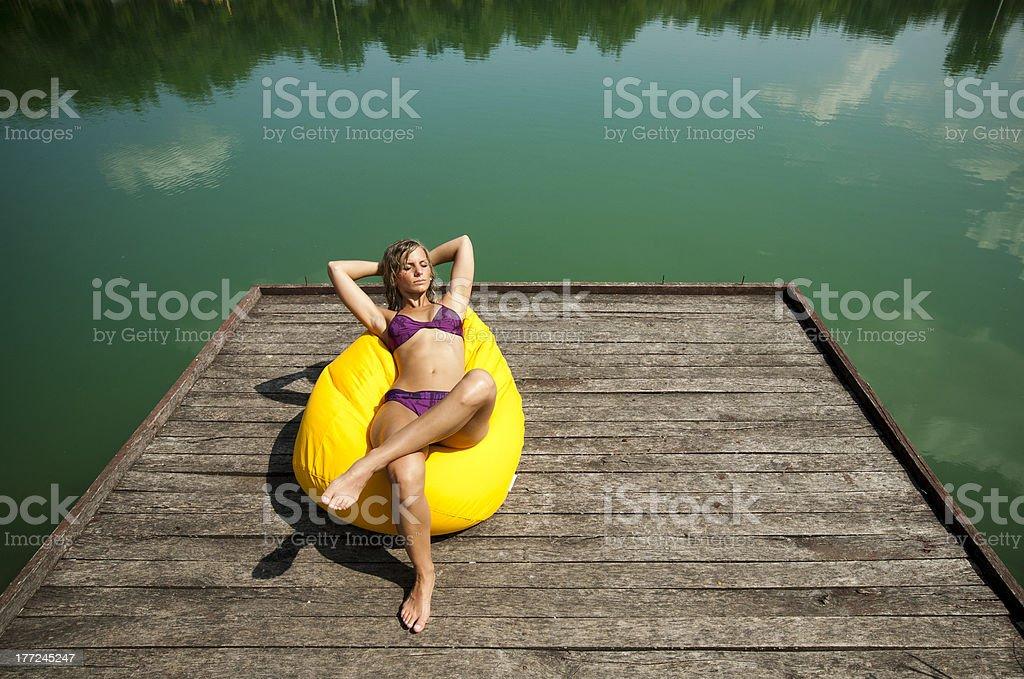 Sexy girl sunbathing. royalty-free stock photo