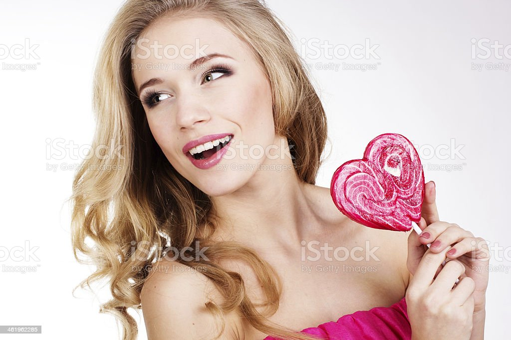 Sexy girl wearing pink dress with candy royalty-free stock photo