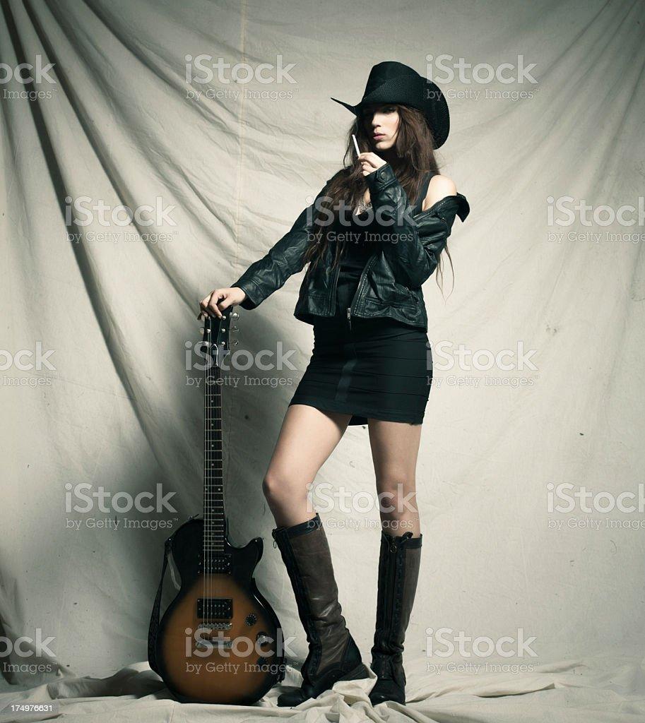 Sexy girl with electro guitar stock photo