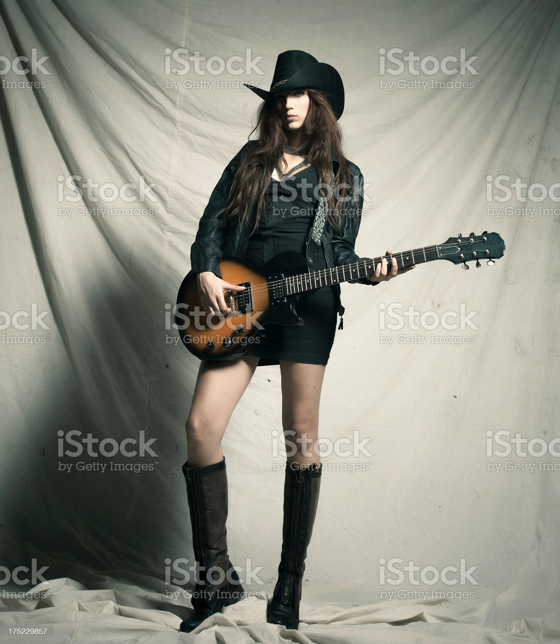 Sexy girl with electro guitar royalty-free stock photo