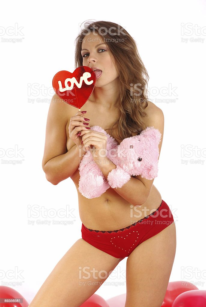 Sexy girl with lollipop and pink teddy bear royalty-free stock photo